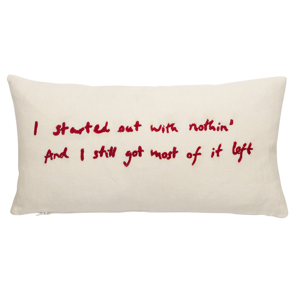 """I started out with nothin' and I still got most of it left"" hand-stitched lyric in red lettering on white 100% linen rectangular cushion or throw pillow"