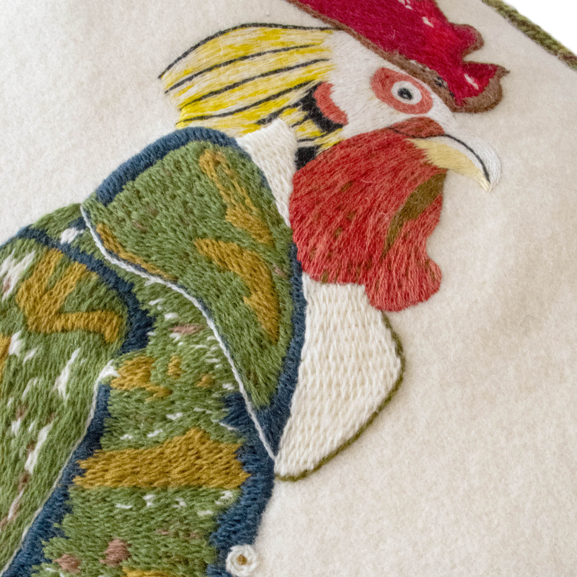 Animaux Hand-Embroidered Cockerel Chicken Wool Cream Green Cushion Fine Cell Work Handmade in Prison
