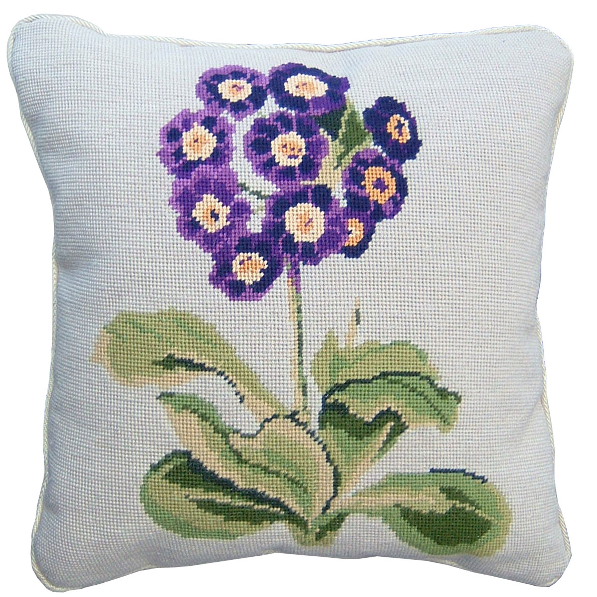 Handmade needlepoint cushion with purple auricula flower on cream background