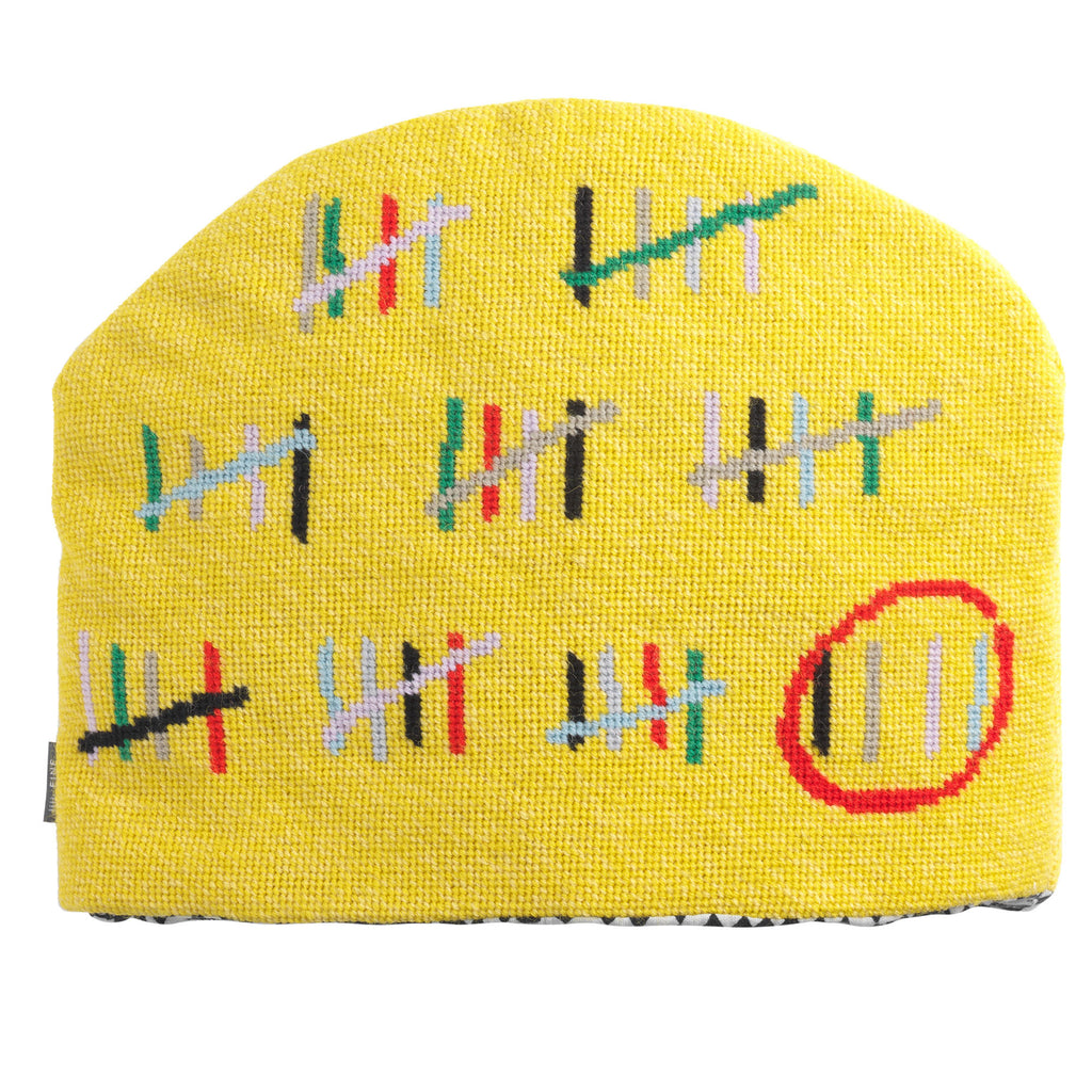 Prison Calendar by AA Gill Tea Cosy in Yellow Fine Cell Work
