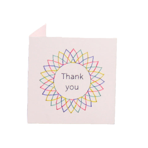 White handmade embroidered thank you greeting card, blank inside.