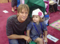 Danielynn Birkhead with Larry Birkhead at trade show modeling Marili Jean, children boutique clothing, kid boutique