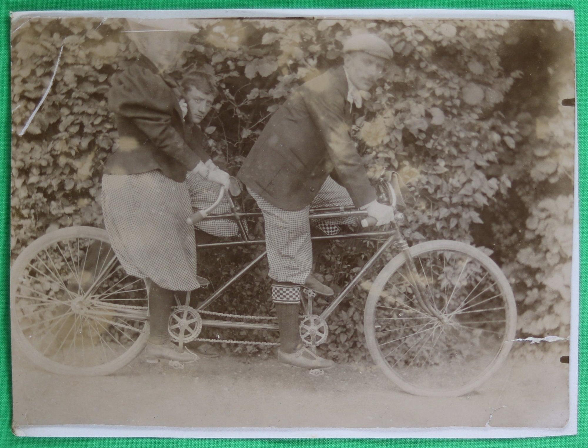 @1900s vintage photo man and woman tandem bicycle