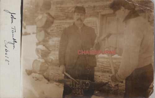 1906 RPPC photo postcard, tradesman front of log cabin Cobalt Ontario