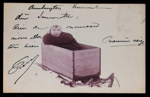 1906 postcard photo of child in sled, Burlington Vermont