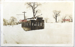 1920 RPPC photo postcard of electric trolley car in snow Newbury MA