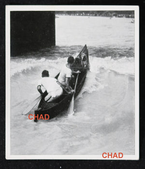 @1930s photo of Canadian canoe team in rapids at German regatta