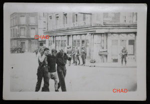 1942 WW2 photo of Canadian POWs carrying wounded friend at Dieppe