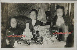Photo postcard of Canadian kids with their Christmas presents c. 1910s