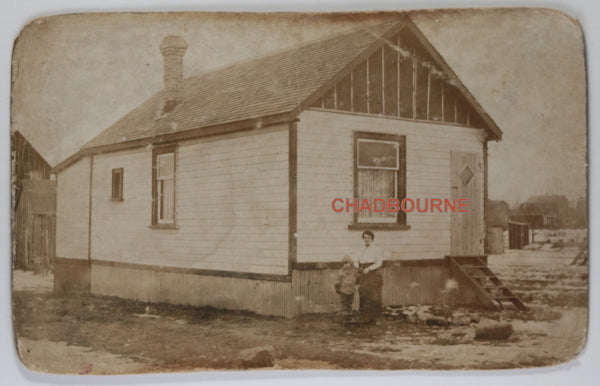 Photo postcard woman and son outside their home, Toronto c. 1918