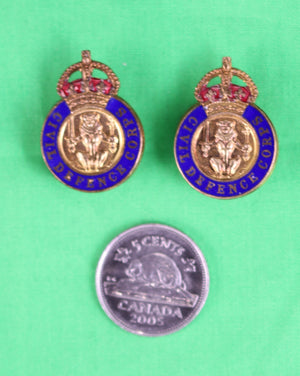 Set of 2 Civil Defence Corps (Scottish version) lapel badges in box.