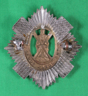 'The Royal Scots' regimental cap badge