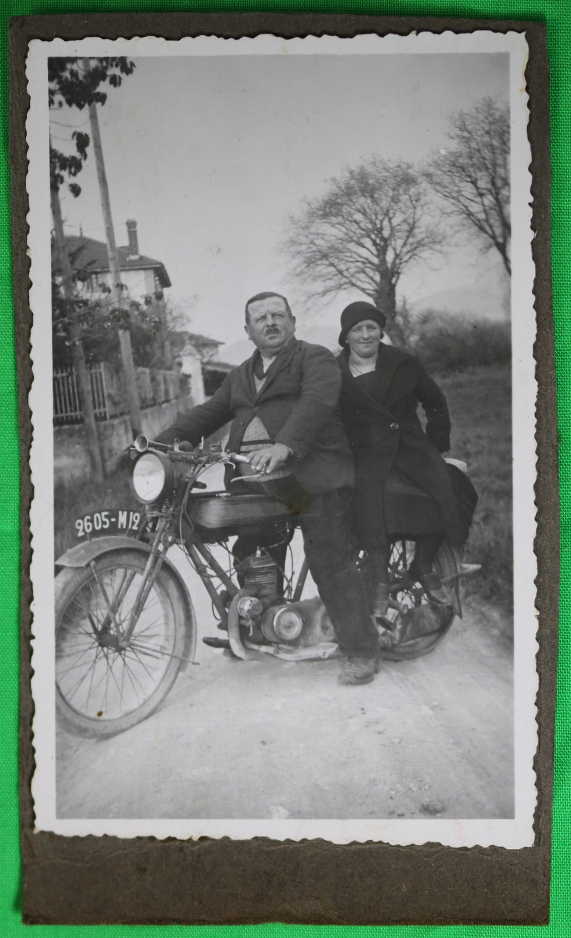 Vintage photo of man and woman on motorcycle @1920s