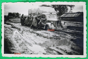 WW2 German troops pushing troop transport through mud in Russia @1941