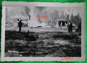 WW2 photo German soldiers in front of Russian houses in flames