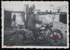 WW2 photo of German soldier on BMW motorcycle