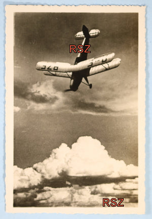 WW2 propaganda photo of Bücker Bü 131 in flight