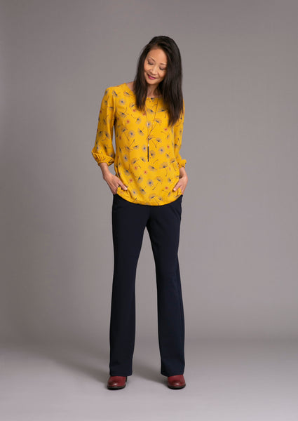 Stretch double crepe knit pants matched with yellow top with flower pattern