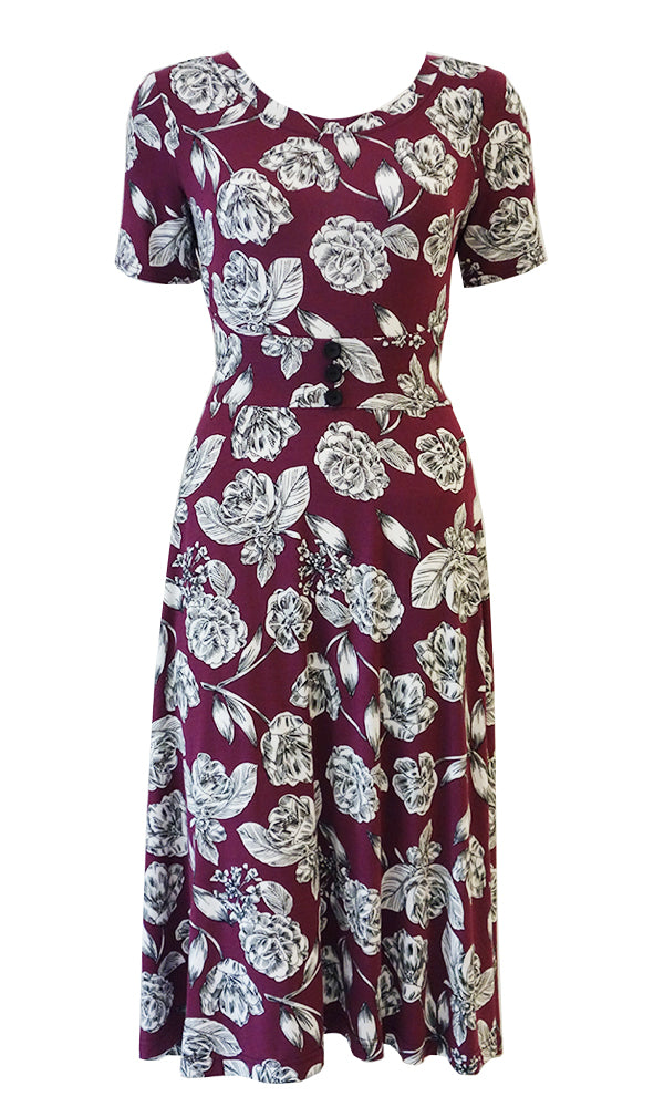 Pink and white floral dress with curved comfort fit waistband, flared skirt and 1/2 sleeves