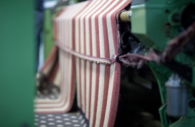 The American Flag wool throw yardage coming off of the loom