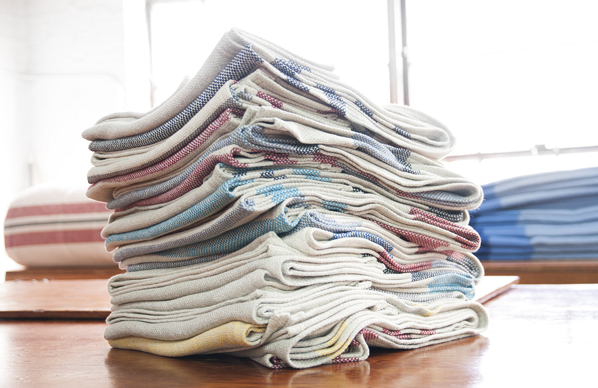 A stack of Eco-Woven cotton throws up on our finishing floor