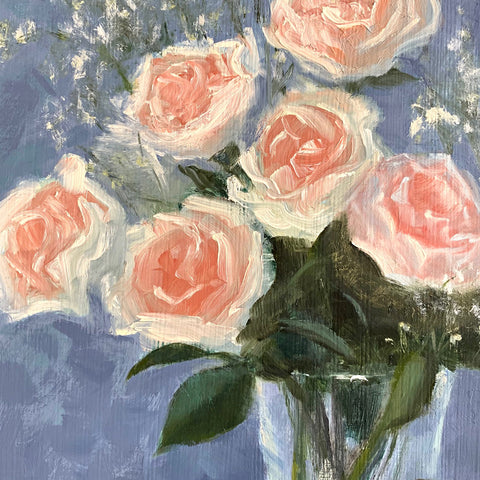 Detail of roses in still life painting of pink roses with baby's breath in a glass vase on white tabletop with a blue background and plant mister in the foreground by Kathy Chumley at Cottage Curator - Sperryville VA Art Gallery