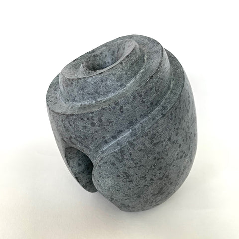 Gray soapstone sculpture resembling a hive with hole in the top center by Robert Bouquet at Cottage Curator - Sperryville VA Art Gallery
