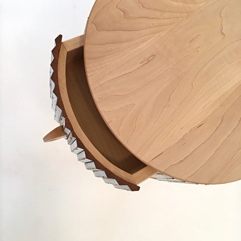 Round, three-legged table in maple and cherry with drawer by Christina Boy at Cottage Curator Sperryville VA