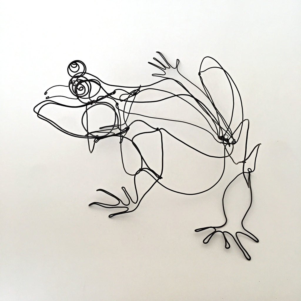 Black wire sculpture of frog by Janet Brome