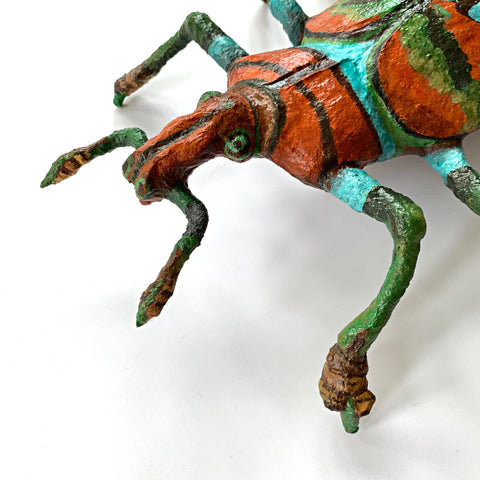 Beetle sculpture made with mixed media in black, green blue and orange by Joan Danziger at Cottage Curator Art Gallery - Sperryville Virginia