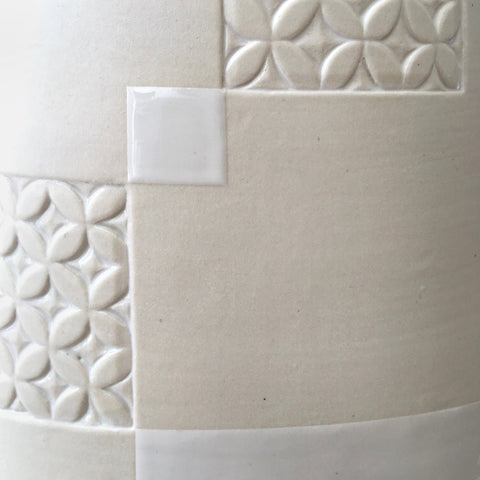 Detail of white porcelain vessel with rectangular patches of carved patterns by Yoshi Fujii at Cottage Curator - Sperryville VA Art Gallery