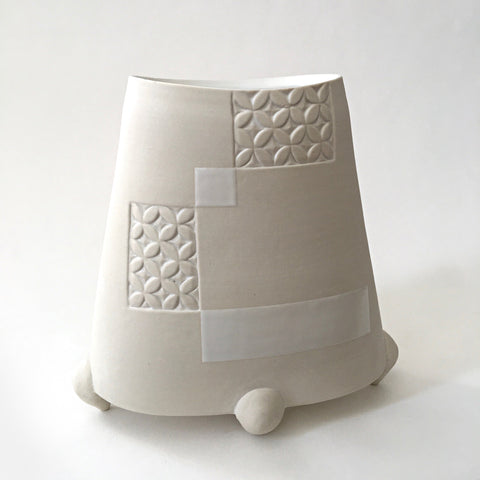 Alternate view of white tapered porcelain vessel with rectangular patches of carved patterns and three feet by Yoshi Fujii at Cottage Curator - Sperryville VA Art Gallery