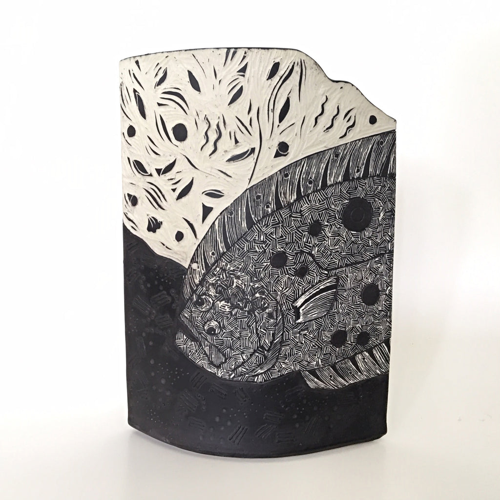 Vase with carving of flounder with head visible in black and white by Shirley Gromen