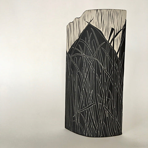 Vase in black and white porcelain with blades of grass by Shirley Gromen at Cottage Curator - Sperryville VA art gallery