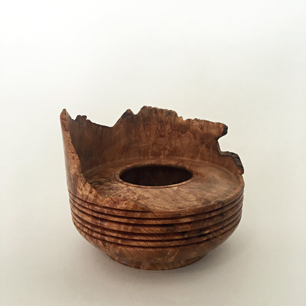 Circular natural wood-turned vessel with uneven top edges by Harriet Maloney at Cottage Curator art gallery