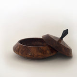Low, flat tapered wood turned vessel with a top by Harriet Maloney at Cottage Curator art gallery