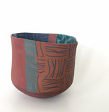 Colorful Nerikomi bowl with varying patterns by Thomas Hoadley