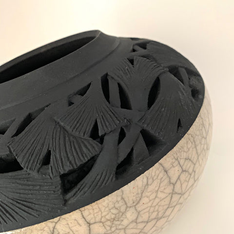 Detail of Ceramic vessel with white crackled lower and black carved upper section with ginkgo leaves by Akiko Koiso at Cottage Curator - Sperryville VA Art Gallery