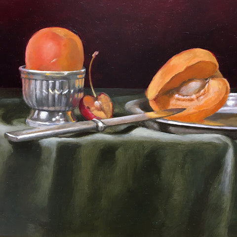 Detail of long, narrow still life with green tablecloth against a dark red background and red and yellow apricots by Davette Leonard at Cottage Curator - Sperryville VA Art Gallery