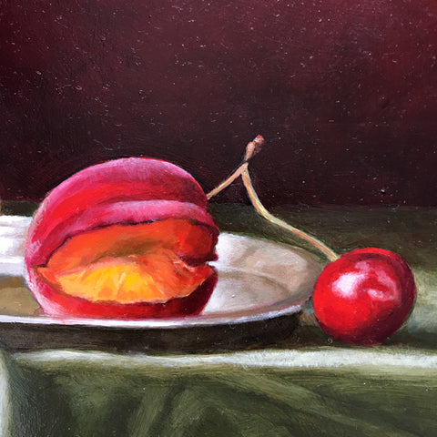 Detail of long, narrow still life with green tablecloth against a dark red background and red apricots by Davette Leonard at Cottage Curator - Sperryville VA Art Gallery