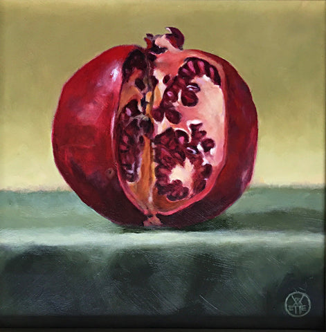 Painting of a pomegranate cut with a knife on a green table cloth by Davette Leonard at Cottage Curator art gallery Sperryville VA