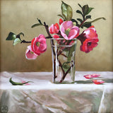 Painting of pink quince with leaves and stems in a vase on a table with white tablecloth and tan background by Davette Leonard at Cottage Curator, Sperryville VA Art Gallery