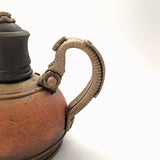 Detail view of industrial ceramic teapot with rivets by Steve Palmer