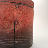 Detail of red ceramic industrial flask vessel with seams by artist Steve Palmer