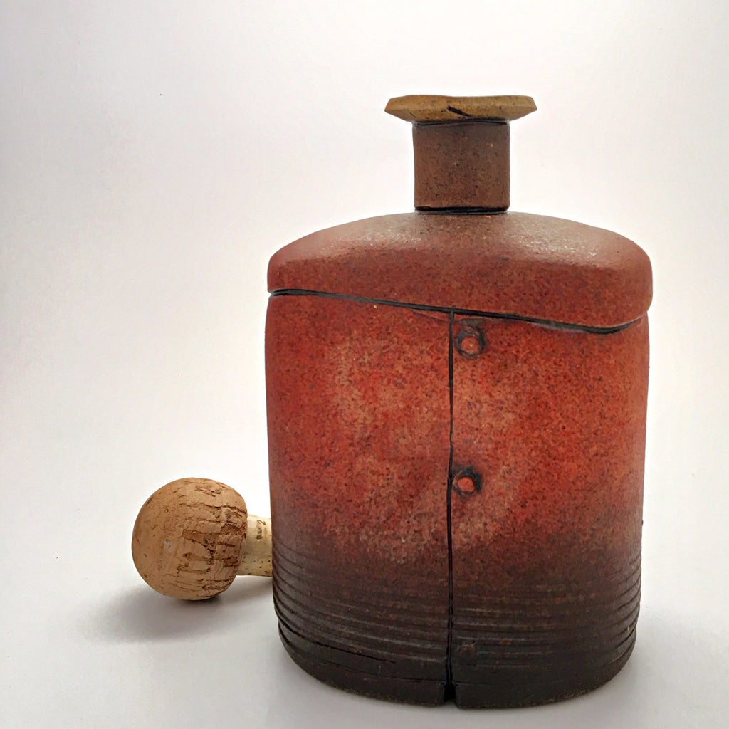 Red ceramic industrial flask vessel with seams by artist Steve Palmer