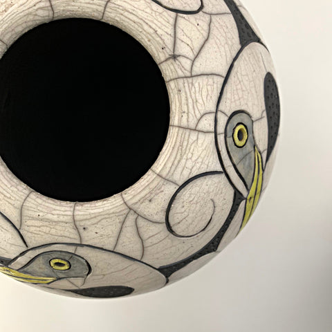 Detail of Wheel Thrown, carved, raku clay vessel in black, white and yellow with four egrets by Robin Rodgers at Cottage Curator - Sperryville VA Art Gallery