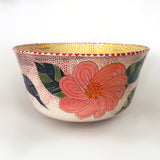 Side view of a ceramic bowl with pink and orange flowers on a red dotted background with yellow polka dots on the interior by Sara Schneidman at Cottage Curator - Sperryville VA Art Gallery