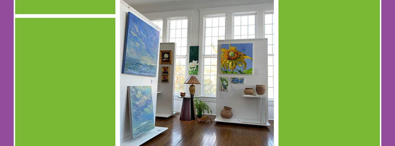 Gallery view featuring paintings, baskets, ceramics, sculpture, and furniture