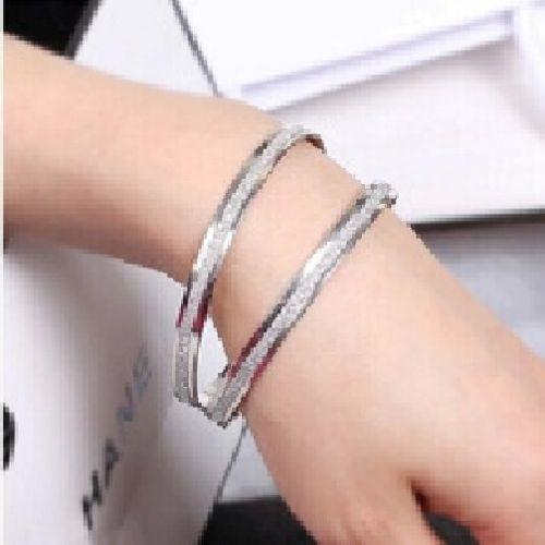 2 18K White Gold Bangle Bracelets