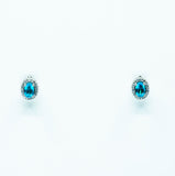 Oval Cut Blue Topaz Earrings